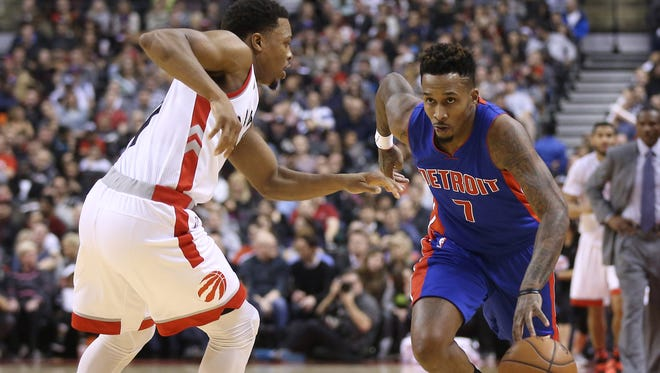 Pistons point guard Brandon Jennings (7) tries to get past Raptors point guard Kyle Lowry (7) during the Pistons' 111-107 loss Saturday in Toronto.