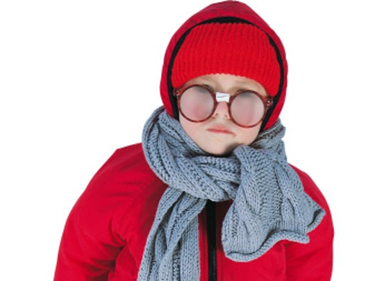 Little boy with glasses bundled up for winter