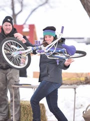 Hartley Riedner of Seattle gives it her best effort in the bike toss contest at last year's Fish Creek Winter Festival.