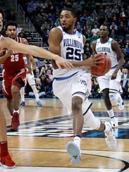 Villanova 's Mikal Bridges (25) drives the lane past