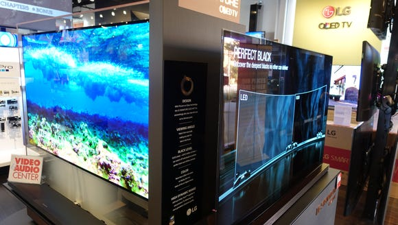 Two LG Signature OLED W7 series TVs on display at Video