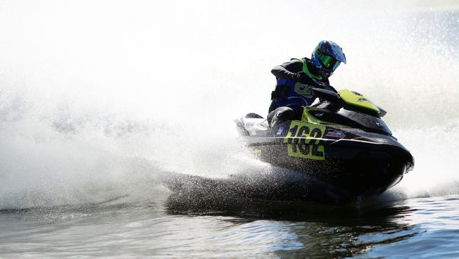 Competitors race during the Pro Watercross World Championship at Sugden Regional Park in East Naples on Thursday, Nov. 2, 2017.
