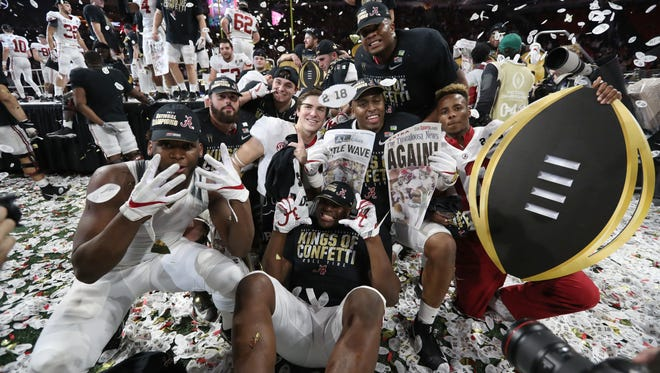 Alabama Crimson Tide players celebrate their championship.