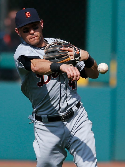 Detroit Tigers' Ian Kinsler throws out Cleveland Indians' Carlos Santana at first base during the first inning of a baseball game, Saturday, April 15, 2017, in Cleveland. (AP Photo/Ron Schwane)