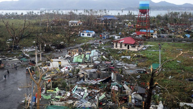 Houses destroyed by Typhoon Haiyan in  Tacloban, on the eastern island of Leyte in the Philippines.