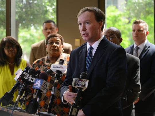 Solicitor Walt Wilkins speaks to the media at City Hall on Monday regarding the outcome of the SLED investigation into the deaths of Officer Allen Jacobs and Deontea Mackey.