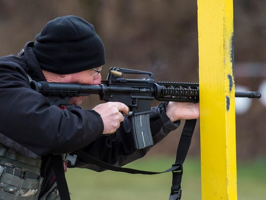 A shooter competes in the rifle portion during the