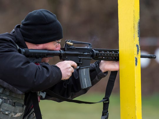 A shooter competes in the rifle portion during the 3-gun competition at the Lebanon County Police Combat Pistol Club on Saturday, April 1, 2017.