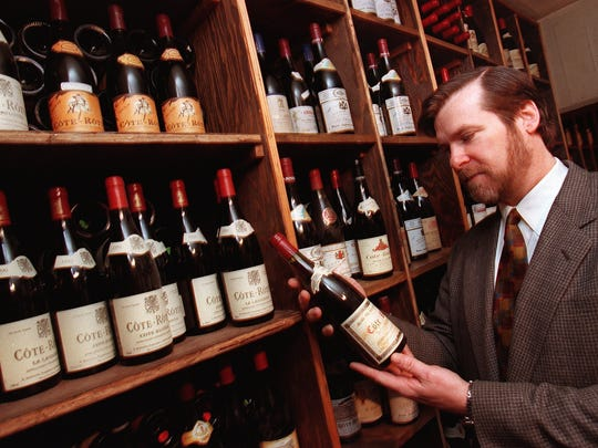 1999: John Crabtree of Crabtree's Kittle House in Chappaqua with a bottle of 1989 Cote Rotie in the restaurant's extensive wine cellar.