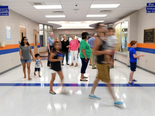 Parents and future students walk the halls of the new South Gibson County Elementary School, Tuesday, July 24.