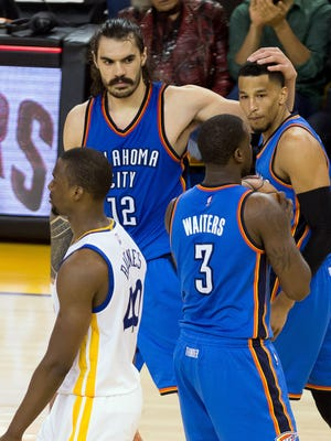 Steven Adams, left, reacts during Game 1.