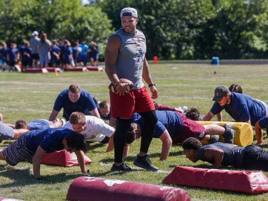 Dylan Cole makes participants in his football camp do push-ups at Logan-Rogersville High School on Saturday, July 7, 2018.