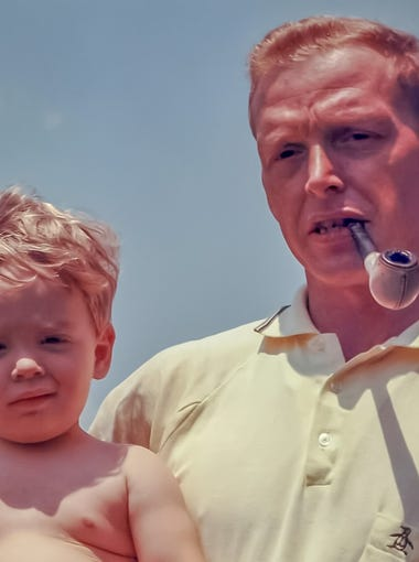 Richard Kibbey holds his youngest son, John, in this family photo taken shortly before he was deployed to Vietnam in 1967.