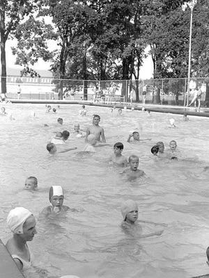Olinger Pool is seen in August 1960. The pool was constructed in 1934 and covered in 1971.
