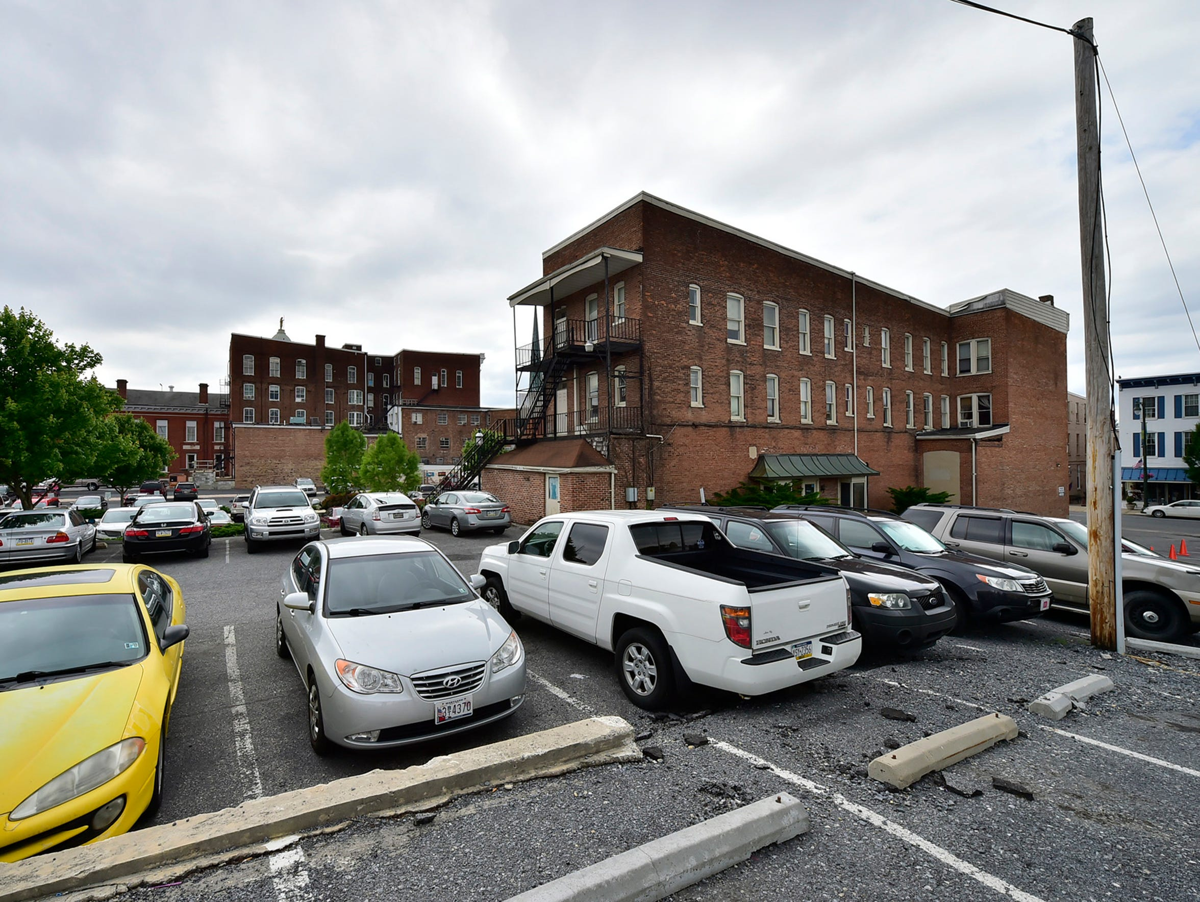 This photo shows the parking lot behind the Franklin County Courthouse complex. Part of this area will be taken up by new construction as part of the courthouse project, dramatically changing the landscape in the first block of North Main Street.