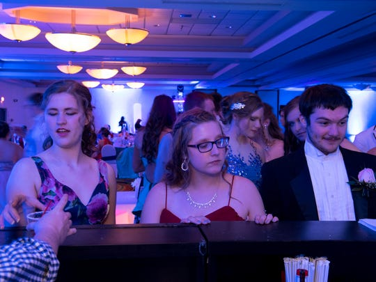 Mocktails are served at the Tecumseh High School prom at the Holiday Inn in Evansville Saturday night.