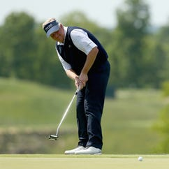 Colin Montgomerie putts on the 16th hole.
