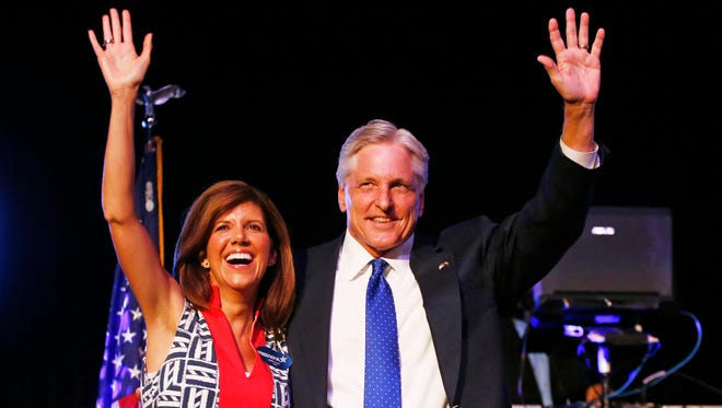 Democratic gubernatorial nominee Fred and Jennifer DuVal smile on election night on Tuesday, Aug. 26, 2014 in Phoenix, AZ.