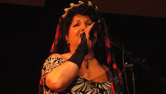 Singer Contessa Dent performs barefoot in tribute to her gypsy grandmother who taught her to sing.
