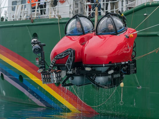 A Greenpeace submarine returns to the surface near Livingston Island, Antarctica, following a dive to the seafloor.