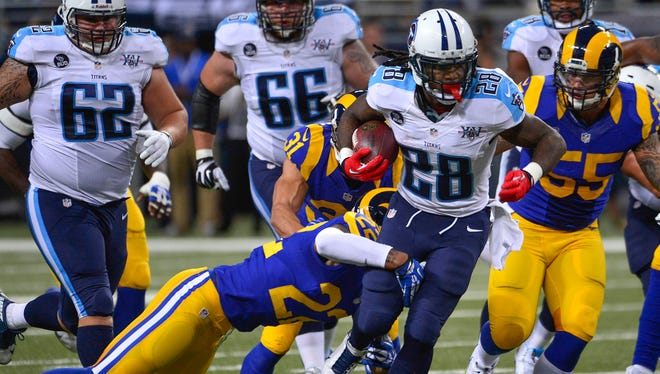 Titans RB Chris Johnson ran around and through the Rams on Sunday.