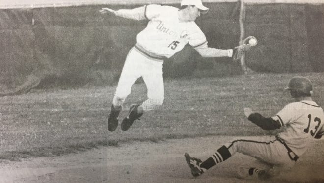 Union County third baseman Allen Dayberry jumped high to grab a throw from his catcher in April 1997.