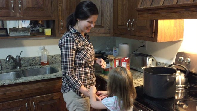 Cara Richardson and her daughter Annica, 3, often make trips to their deep freezer for dinner. Planning and preparing meals ahead is one way Richardson stays sane and healthy.