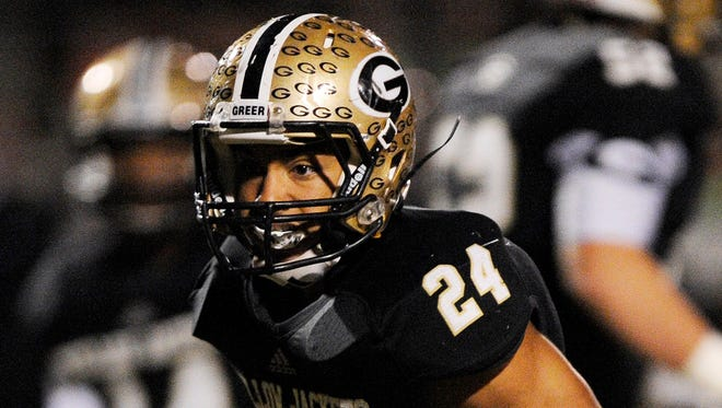 Adrian McGee (24) and the Greer Yellow Jackets beat Clinton 17-13 to open the Class AAA playoffs Friday, Nov. 7, 2014.