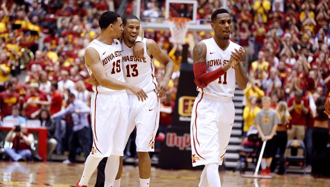 Bryce Dejean-Jones (13) is hugged by teammate Naz Long, left. Monte Morris (11) also is pictured. Dejean-Jones has been a central part of the Iowa State team in a 6-1 start.