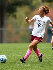 Morristown's Caitlin Rempson passes vs. Chatham NJAC-United girls soccer match.  October 11, 2017. Morristown, New Jersey