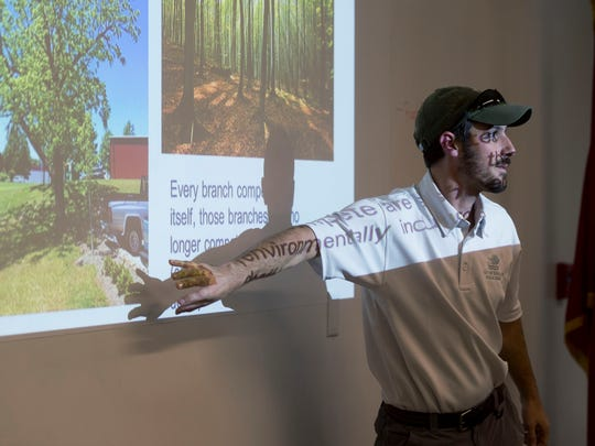 Kasey Krouse, urban forester with the City of Knoxville, leads a class on tree pruning for the nonprofit organization Trees Knoxville.