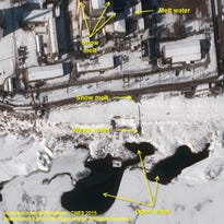 This satellite photo shows signs  indicating new activity at the 5 MWe Plutonium Production Reactor at North Korea's Nyongbyon Nuclear Scientific Research Center.