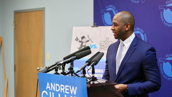 Tallahassee Mayor Andrew Gillum unveils plan to increase corporate taxes to pay for public education during news conference at Florida Press Center.