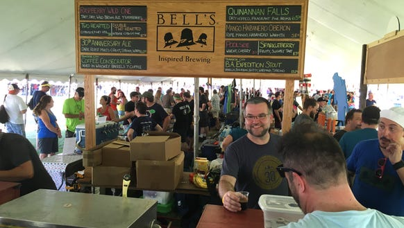 Bell's Brewing workers dispense beer samples Friday