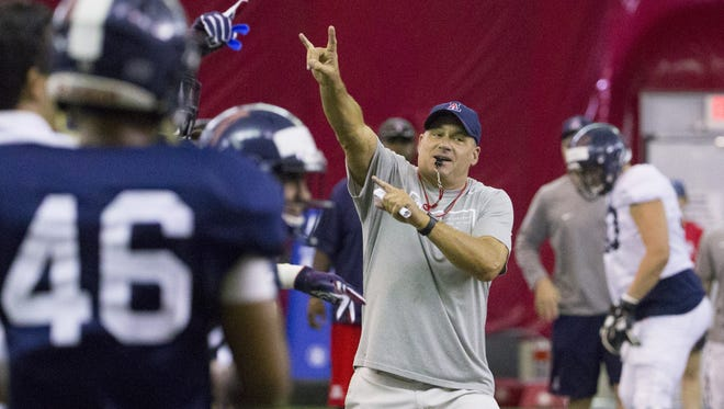 Arizona football coach Rich Rodriguez instructs his team during practice at the Arizona Cardinals' training facility in Tempe on August 10, 2016.