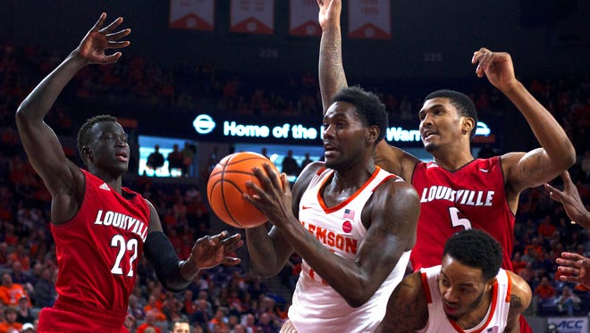 Clemson Tigers forward Elijah Thomas (14) gets the rebound while being defended by Louisville Cardinals center Steven Enoch (23) and forward Malik Williams (5) during the second half at Littlejohn Coliseum in Clemson, South Carolina, on Saturday, Jan. 6, 2018.
