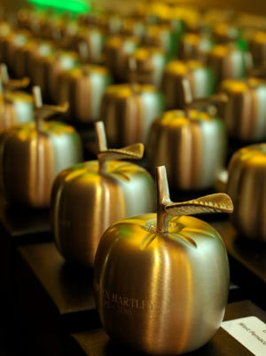 Dozens of teachers throughout the Escambia County School District were honored as teachers of the year representing their various schools Thursday night during the Golden Apple Awards held at New World Landing.