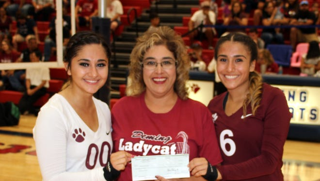 "Deming Elks Lecturing Knight Yvonne Jasso, center, handed a check in the amount of $600 to senior Lady Cats Myka Trevizo, right, and Julyssa ""Boo"" Ortiz in support od the Deming High School Lady Wildcat Volleyball Program. The Deming Elks Lodge 2750 makes it a priority to help veterans and youth in the community of Deming, Columbus and Luna County."