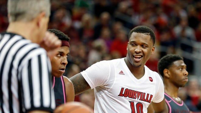 Louisville's Jaylen Johnson smiles after Virginia Tech's Zach LeDay gets called for a lane violation.   Feb. 18, 2017