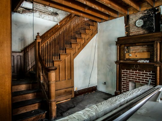 The original staircase and living room fireplace trim
