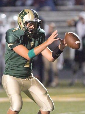 Matt Hornyak, Howell High School quarterback, receives a snap Friday, Sept. 8, 2017 in the home game against Novi.