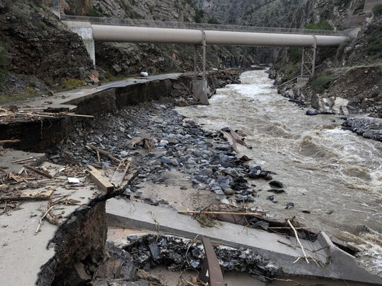 Flood damaged U.S. Highway 34 and debris are pictured next to the Big Thompson River near the Narrows during a media tour in the canyon and downstream Tuesday September 17, 2013.