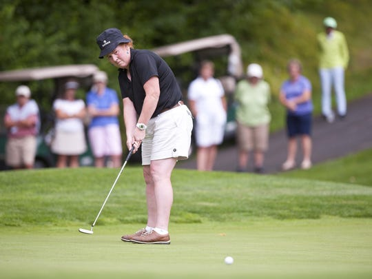 Holly Reynolds rolls a birdie putt on the 18th green during the Vermont Women's Amateur at Green Mountain National Golf Course in Killington on Wednesday. Reynolds shot a final-round 72 to win her eighth amateur title.