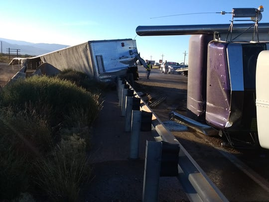 A semitrailer rolled onto it side then crashed into