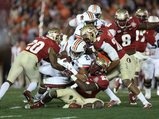FSU's defense makes a stop during the 2013 BCS National Championship