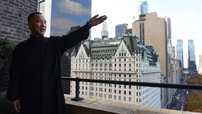 Billionaire Guo Wengui, who is seeking asylum in the United States after accusing officials in his native China of corruption, poses at his New York City apartment on Nov. 28, 2017.
