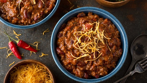 A bowl of delicious home made chili with ground beef,