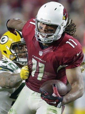 Arizona receiver Larry Fitzgerald breaks away for a 75-yard pass play in overtime to set up the Cardinals for a winning touchdown in a 2015 playoff games against the Packers.