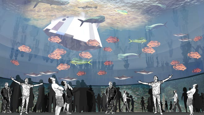 A proposed aquarium exhibit that features a large tank containing ocean fish also would included a model of the Orion space capsule floating at the surface.