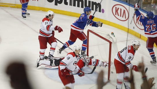 The New York Rangers celebrate a goal by left wing